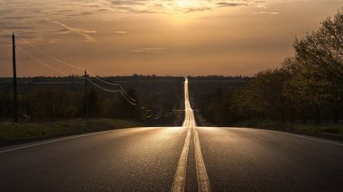 69201__undulating-straight-highway-at-sundown_p